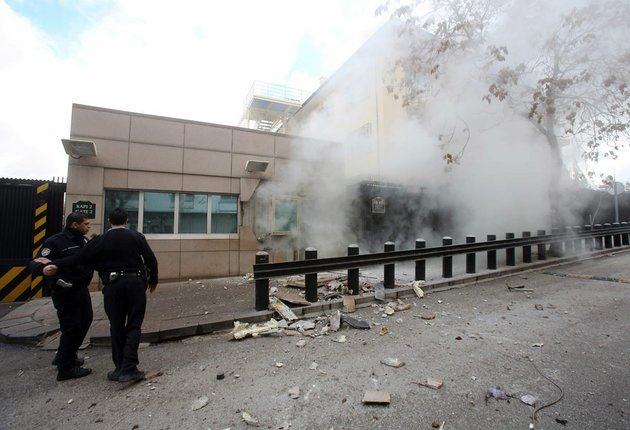 two-police-officers-arrive-at-gate-2-of-the-us-embassy-just-minutes-after-a-suicide-bomber-has-detonated-an-explosive-device-at-the-entrance-of-the-us-embassy-in-the-turkish-capital-ankara-turkey-on-friday-feb-1-2013