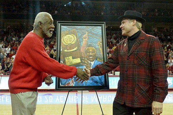 NWA Media/MICHAEL WOODS --02/02/2013-- Former University of Arkansas basketball coach Nolan Richardson shakes hand with artist Opie Otterstad during a halftime presentation of Saturday afternoon's game against Tennessee at Bud Walton Arena in Fayetteville.