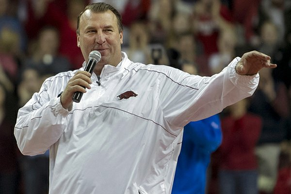 Arkansas head football coach Bret Bielema speaks during a time out in the first half of a NCAA college basketball game against Tennessee in Fayetteville, Ark., Saturday, Feb. 2, 2013. Arkansas defeated Tennessee 73-60. (AP Photo/Gareth Patterson)