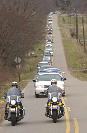 Police escorts for funeral processions, as seen in this 2003 Northwest Arkansas Times photo, once were common in Arkansas towns. Today, only four of Arkansas' largest cities still provide the service.