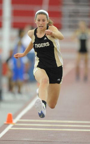 McKenzie Dixon of Bentonville competes in the triple jump Saturday during the state indoor track and field championships at the Randal Tyson Track Center in Fayetteville.
