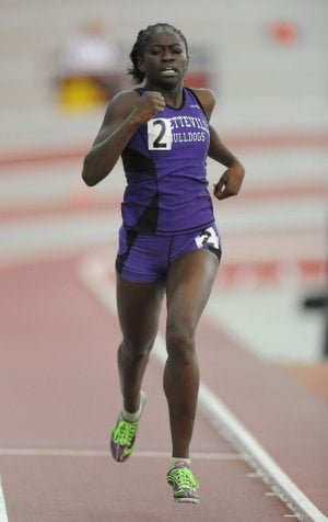 Fayetteville's Amanda Agana leads the field in the 800 meters during the state indoor track and field championships at the Randal Tyson Track Center in Fayetteville.