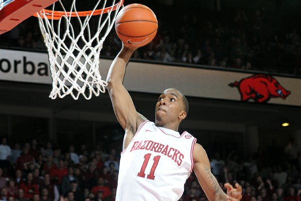 Arkansas' BJ Young dunks the ball in the second half of the game Tuesday, Feb. 5, 2013, against No. 2 Florida at Bud Walton Arena in Fayetteville. Arkansas upset the Gators, 80-69.