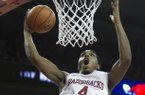 Arkansas' Coty Clarke (4) dunks during the second half an NCAA college basketball game against No. 2 Florida in Fayetteville, Ark., Tuesday Feb. 5, 2013. Arkansas won 80-69. (AP Photo/Gareth Patterson)