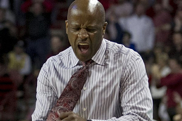 Arkansas' head coach Mike Anderson celebrates after a foul call during the second half an NCAA college basketball game against Florida in Fayetteville, Ark., Tuesday Feb. 5, 2013. Arkansas defeated No. 2 Florida 80-69. (AP Photo/Gareth Patterson)
