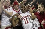 Arkansas' BJ Young (11) celebrates with fans after their 80-69 win over No. 2 Florida in an NCAA college basketball game in Fayetteville, Ark., Tuesday, Feb. 5, 2013. (AP Photo/Gareth Patterson)