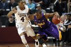 LSU guard Anthony Hickey (1) pushes past Mississippi State guard Trivante Bloodman (4) during the second half of an NCAA college basketball game in Starkville, Miss., Saturday, Feb. 2, 2013. LSU won 69-68. (AP Photo/Rogelio V. Solis)