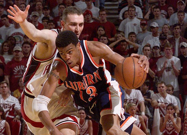 auburns-bryant-smith-13-drives-the-lane-as-arkansas-pat-bradley-left-guards-him-during-the-second-half-wednesday-feb-24-1999-in-bud-walton-arena-in-fayetteville-ark-arkansas-won-104-88-ap-photogary-yandell