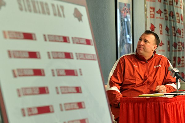 University of Arkansas head football coach Bret Bielema talks about the 22 players who committed to the Razorbacks as he conducts a press conference Wednesday afternoon in Fayetteville.