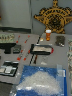 A display of items seized by the Benton County Sheriff's Office in a Rogers drug sting.