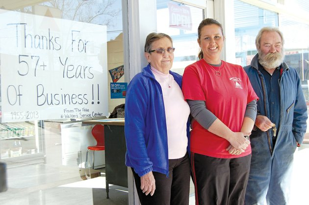 the-sale-of-walters-service-center-in-downtown-conway-was-finalized-friday-to-phil-and-diana-hawks-kirkland-standing-in-front-of-the-station-are-from-the-left-former-owner-virginia-walter-dee-ann-walter-davis-who-managed-the-station-and-ed-erbach-a-45-year-employee-of-the-business-started-57-years-ago-by-the-late-martin-walter-the-business-will-remain-open-as-it-is-remodeled-to-become-central-station-convenience-store-the-kirklands-said-they-will-keep-the-stations-full-service-amenities