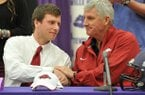 Fayetteville High's Austin Allen shakes hands with his father Bobby Allen after signing his letter of intent to play football at the University of Arkansas during the official signing ceremony Wednesday, Feb. 6, 2013, at Fayetteville High School.