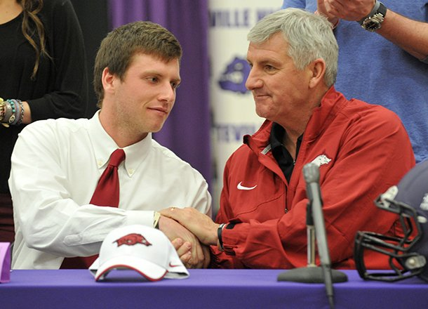 fayetteville-highs-austin-allen-shakes-hands-with-his-father-bobby-allen-after-signing-his-letter-of-intent-to-play-football-at-the-university-of-arkansas-during-the-official-signing-ceremony-wednesday-feb-6-2013-at-fayetteville-high-school