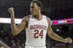Arkansas' Michael Qualls argues a call during the first half an NCAA college basketball game against Florida in Fayetteville, Ark., Tuesday Feb. 5, 2013. (AP Photo/Gareth Patterson)