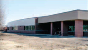 The facade of a new addition to Gravette Middle School appears similar to the old school building it replaces. The entrance/office area is in the same location as before, while a curved front facade adds an attractive contrast to the present middle school which it joins. Also an eye-catching entrance approach is not shown in the photo.