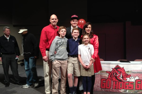 Hunter Henry poses with his family after signing with the Razorbacks on National Signing Day, Feb. 6, 2013.