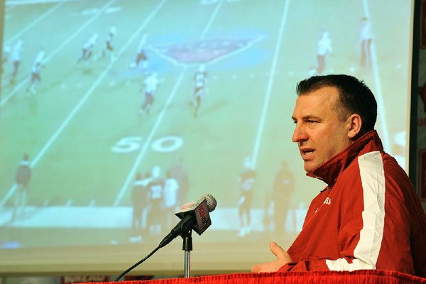 NWA Media/MICHAEL WOODS  --02/06/2013-- University of Arkansas head football coach Bret Bielema talks about the 22 players who committed to the Razorbacks as he conducts a press conference Wednesday afternoon in Fayetteville to talk about the new Razorback players.