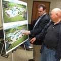 Andrew Smith (left) with Larkin Aquatics of Kansas City, Mo., describes features of the planned aqua...