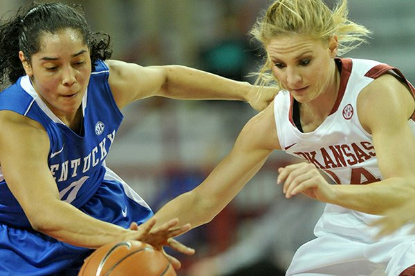 Kentucky defender Jennifer O'Neill knocks the ball away from Arkansas' Erin Gatling during the first half of Thursday night's game against the Wildcats at Bud Walton Arena in Fayetteville.