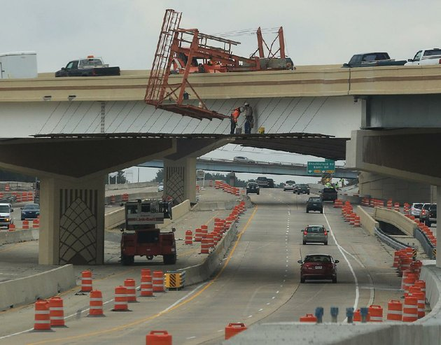 file-workers-paint-one-of-the-overpasses-on-feb-8-as-work-continues-at-the-big-rock-interchange-at-interstates-430-and-630-in-west-little-rock