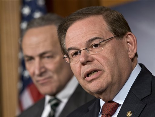 in-this-monday-jan-28-2013-file-photograph-sen-robert-menendez-d-nj-right-and-sen-charles-schumer-d-ny-left-announce-with-other-senators-that-they-have-reached-agreement-on-the-principles-of-sweeping-legislation-to-rewrite-the-nations-immigration-laws-during-a-news-conference-at-the-capitol-in-washington-menendez-said-monday-feb-4-2013-that-allegations-that-he-engaged-with-prostitutes-in-the-dominican-republic-are-false-smears-he-said-he-has-done-nothing-wrong-and-that-allegations-otherwise-are-totally-unsubstantiated