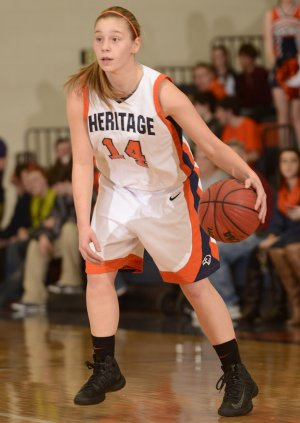 Emilie Jobst of Rogers Heritage looks for a lane to the basket on Feb. 1 during the Lady War Eagles' game against Fayetteville at War Eagle Arena in Rogers.