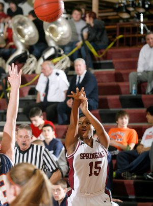Javonda Daniels, Springdale High sophomore, attempts a 3-pointer Tuesday against Rogers Heritage in Springdale.