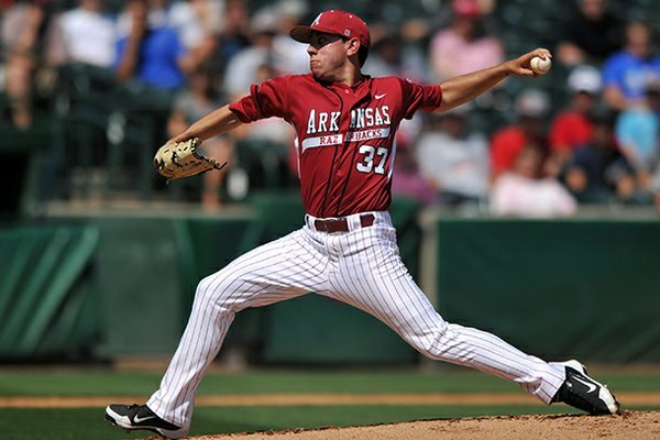 Arkansas pitcher Trent Daniel fires a pitch during a 2012 game against Missouri at Baum Stadium in Fayetteville.