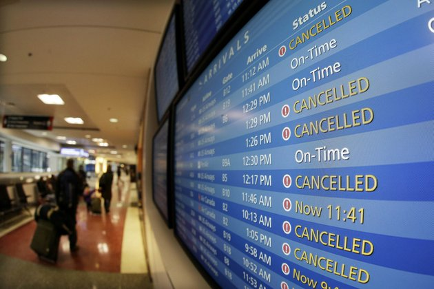 tv-monitors-at-logan-international-airport-in-boston-show-cancelled-flights-friday-morning-feb-8-2013