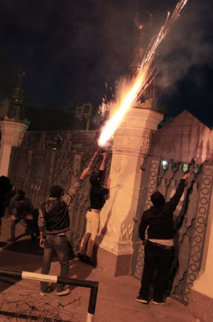 Egyptian protesters set off fireworks Friday at the presidential palace during a demonstration in Cairo.