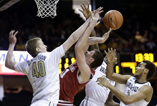 Arkansas forward Hunter Mickelson, second ...