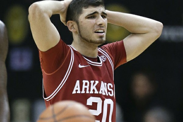Arkansas guard Kikko Haydar walks down the court after Arkansas was called for a foul late in the second half of an NCAA college basketball game Saturday, Feb. 9, 2013, in Nashville, Tenn. Vanderbilt won 67-49. (AP Photo/Mark Humphrey)