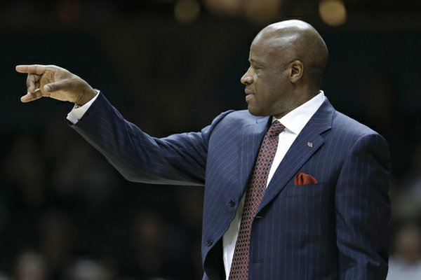 Arkansas head coach Mike Anderson motions to his players in the first half of an NCAA college basketball game against Vanderbilt on Saturday, Feb. 9, 2013, in Nashville, Tenn. (AP Photo/Mark Humphrey)