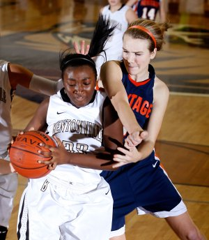 Bentonville's Jamayne Potts, left, is fouled by Rogers Heritage senior Ellen Lundy as she pulls down a defensive rebound during the second half on Friday at Bentonville.