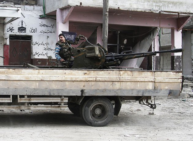 in-this-friday-february-8-2013-photo-a-free-syrian-army-fighter-sits-behind-his-antiaircraft-machine-gun-in-aleppo-syria-syrian-rebels-brought-their-fight-within-a-mile-of-the-heart-of-damascus-on-friday-seizing-army-checkpoints-and-cutting-a-key-highway-with-a-row-of-burning-tires-as-they-pressed-their-campaign-for-the-heavily-guarded-capital-considered-the-likely-endgame-in-the-nearly-2-year-old-civil-war