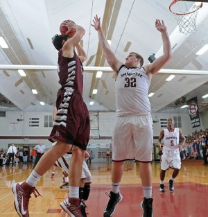 Josiah Wymer, right, of Springdale High tries to block the shot by Siloam Springs' Payton Henson on Friday in Springdale.