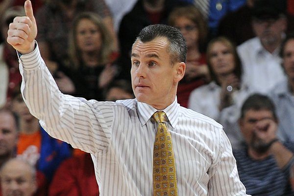 Florida's Billy Donovan, head coach, gives a thumbs up to players Tuesday, Feb. 5, 2013, at Bud Walton Arena in Fayetteville. The Gators were one of the four, top-five teams to be upset last week.