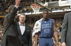 Mississippi's Reginald Buckner, right, is escorted off the court after being ejected during the second half of an NCAA college basketball game against Missouri on Saturday, Feb. 9, 2013, in Columbia, Mo. Missouri won 98-79. (AP Photo/L.G. Patterson)