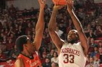 Arkansas junior Marshawn Powell shoots as Auburn senior Noel Johnson (32) defends him, Jan. 16, 2013 in Bud Walton Arena in Fayetteville. The Razorbacks beat the Tigers 88-80 in double overtime.