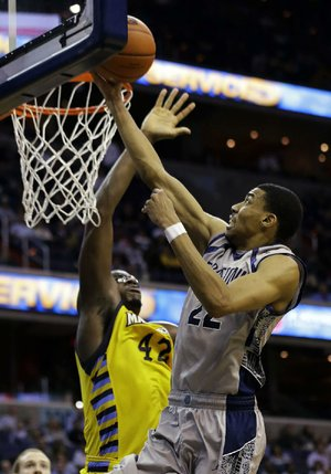 Georgetown forward Otto Porter Jr. (22) shoots over Marquette center Chris Otule (42) during the second half of Monday's game in Washington. Porter had 21 points as Georgetown won 63-55.