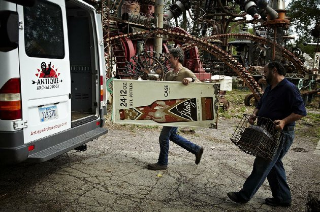 american-pickers-modern-archeologists-mike-wolfe-left-and-frank-fritz-load-up-their-latest-finds-destined-for-a-collector-or-lover-of-antiques