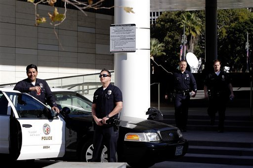 los-angeles-police-officers-stand-alert-at-the-lapd-headquarters-in-los-angeles-on-tuesday-feb-12-2013-police-are-now-investigating-more-than-1000-tips-from-the-public-in-the-search-for-the-christopher-dorner-who-is-suspected-of-a-deadly-revenge-plot-against-the-los-angeles-police-department-the-number-of-tips-has-grown-from-an-initial-250-since-the-city-offered-a-1-million-reward-for-information-leading-to-the-capture-of-dorner