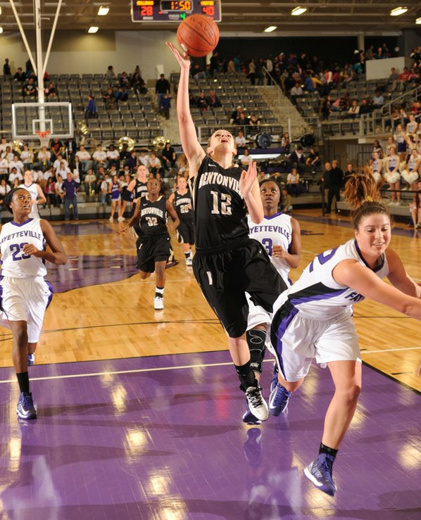 Bentonville's Taylor Lee (12) reaches ...