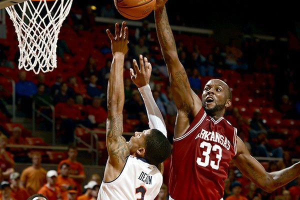 Arkansas' Marshawn Powell blocks a shot by Auburn's Chris Denson during the second half of their NCAA college basketball game, Wednesday, Feb. 13, 2013, in Auburn, Ala. Arkansas won 83-75. (AP Photo/Todd J. Van Emst)