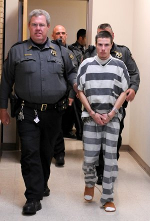 Zachary Holly is escorted to court Nov. 28 for arraignment on charges related to the death of 6-year-old Jersey Bridgeman at the Benton County Courthouse in Bentonville. On Tuesday, Circuit Judge Brad Karren granted a motion to have Holly sent to Little Rock for a mental evaluation.