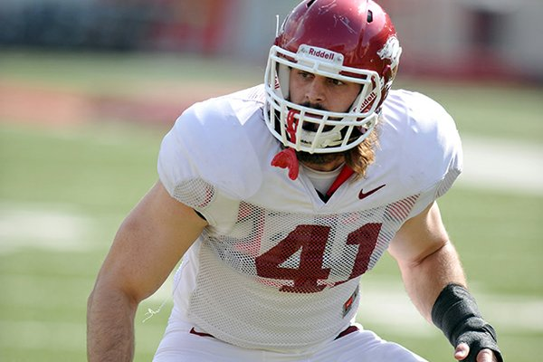 Arkansas defender Austin Flynn runs drills during a 2012 practice at Donald W. Reynolds Razorback Stadium in Fayetteville.