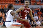 Auburn's Josh Wallace (11) defends Arkansas' Rickey Scott (3) during an NCAA college basketball game on Wednesday, Feb. 13, 2013, at Auburn Arena in Auburn, Ala. The Razorbacks beat the Tigers 83-75.(AP Photo/Al.com, Julie Bennett)