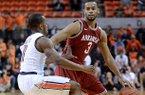 Auburn's Josh Wallace (11) defends Arkansas' Rickey Scott (3) during an NCAA college basketball game on Wednesday, Feb. 13, 2013, at Auburn Arena in Auburn, Ala. The Razorbacks beat the Tigers 83-75.(AP Photo/Al.com, Julie Bennett)