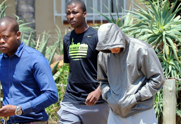 olympic-athlete-oscar-pistorius-leaves-the-boschkop-police-station-east-of-pretoria-south-africa-on-thursday-feb-14-2013-en-route-to-appear-in-court-charged-with-murder