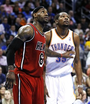 Miami Heat forward LeBron James (left) had 39 points, 12 rebounds and 7 assists to beat Kevin Durant (right) and the Oklahoma City Thunder 110-100 on Thursday night.